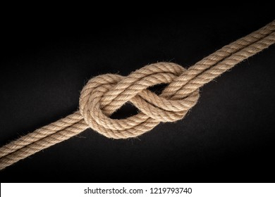 Double Figure Eight knot on black background. Rope node