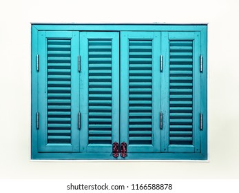 Double folding louvered window in retro style with sliding lock .Louvered window shutters.