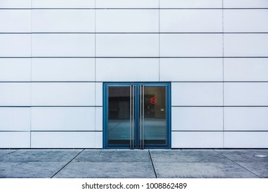 A double glass door on a white wall, France.