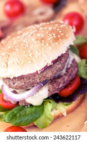 Double hamburger with cheese, salad and onion