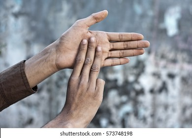 Double handed  British  Sign Language (BSL) is the predominant sign language of Deaf communities in the United States and most of anglophone Canada.