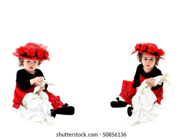 Double image of little girl playing with her old fashioned rag doll and wearing an old fashioned red, straw hat.  She is sitting in an all white room and playing with her doll.