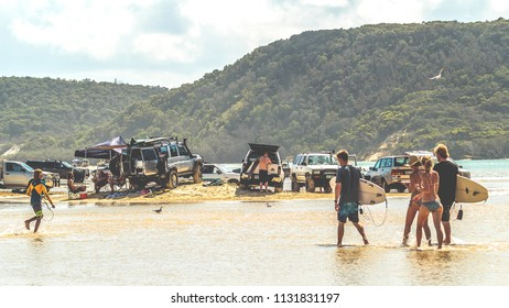 DOUBLE ISLAND POINT, QUEENSLAND, AUSTRALIA - February 18, 2018:  Vehicles on the last of the high ground left at the top of a large high tide.