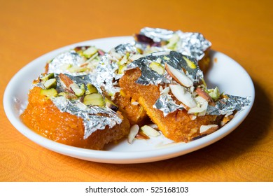 Double Ka Meetha is popular Hyderabadi dessert made with fried bread soaked in sugar syrup with a touch of Saffron and topped with nuts and Warq