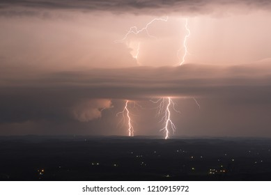 double lighting bolt strikes cloud to ground.