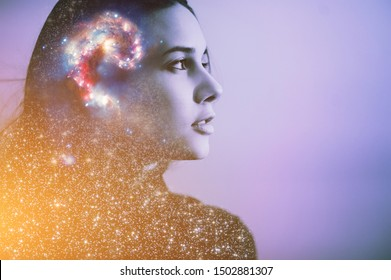Double multiply exposure abstract portrait of a dreamer cute young woman face with galaxy universe space inside head. Spirit cosmos astronomy life zen concept Elements of this image furnished by NASA