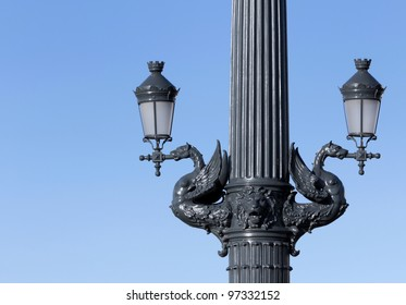 Double ornate street lamps.