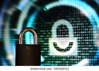 double padlock. iron padlock and digital padlock symbol in screen display in the background. double security. maximum security and protection concepts.