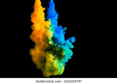 double paint stream in water, colored ink cloud, abstract background, process of mixing multicolored dye on a black background
