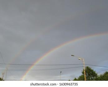 Double rainbow after rain over the city