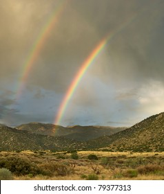 A double rainbow appears over Albuquerque's Sandia Mountains during the monsoon season