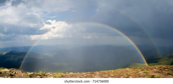 Double rainbow on top of the mountain