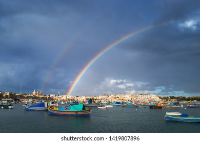 Double rainbow over the fisher village Marsaxlokk, Malta