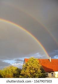 a double rainbow over the houses