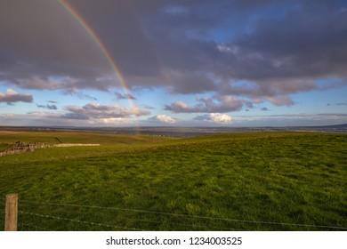 Double rainbow over meadow in Ireland