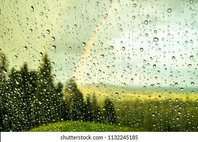 Double rainbow with raindrops tru my car window after a summer rain.