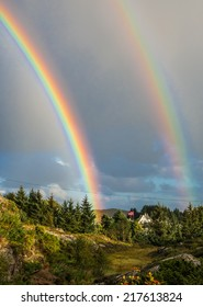 Double rainbow in sky over the forest in Oygarden islands in Horoland, Norway