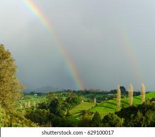Double rainbow at Waitomo , New Zealand