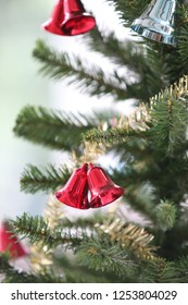 double red bells on christmas tree