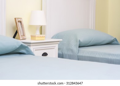 double room with separate beds and lamp