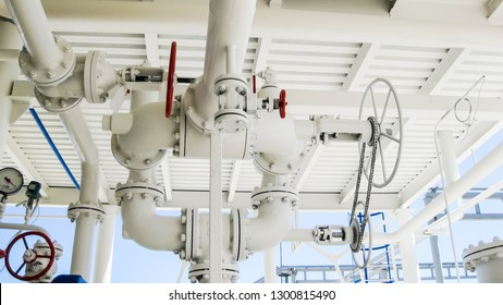 Double safety valve on the pressure vessel. Refinery equipment. Oil refinery. Equipment for primary oil refining.