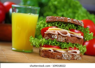 Double sandwich with chicken brest, tomato, cheese and lettuce.sandwich