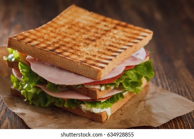 double sandwich with ham and tomato