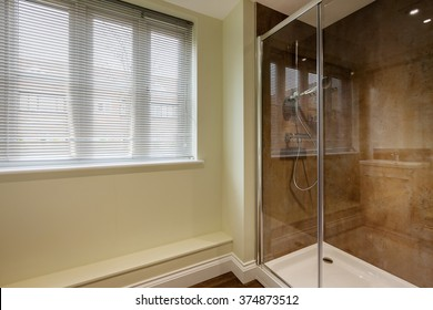 Double shower cubicle with Glass sliding doors and large window with venetian blind