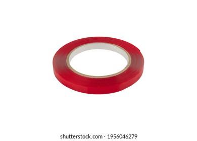 Doppelseitige Klebebandfolie. rote Bänderwalze einzeln auf weißem Hintergrund