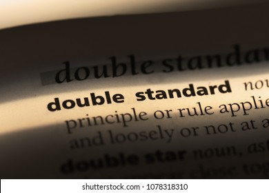 double standard word in a dictionary. double standard concept