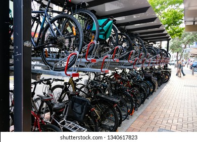Double storey bike rack in city. Efficient storage and environmentally friendly. Wellington New Zealand 4th March 2019