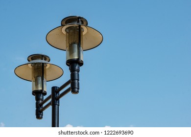 double street lamp on blue sky background