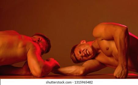 Double strength. Men competitors try to win victory or revenge. Strength skills. Revenge in sport. Twins men competing till victory. Twins competitors arm wrestling.