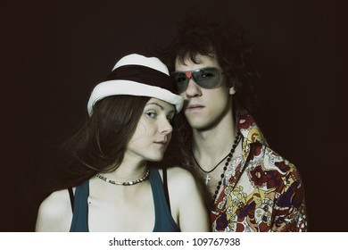Double studio portrait of young lovers, men and women on a black background
