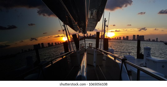 Double sunset reflection over the window of  a yacht in Miami, Floria