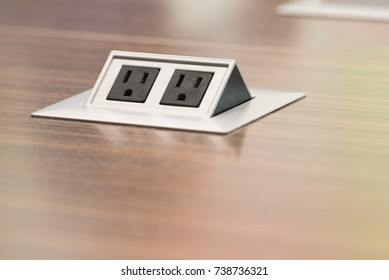 Double Three Prong Pop Up Electrical Outlet in Business Conference Office Table Networking Meetings and Getting Plugged In and Charged Up