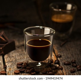 double wall glass with espresso on a wooden table