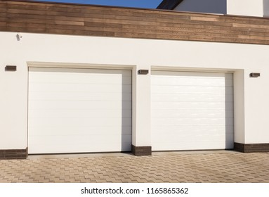 Double white gate to the garage