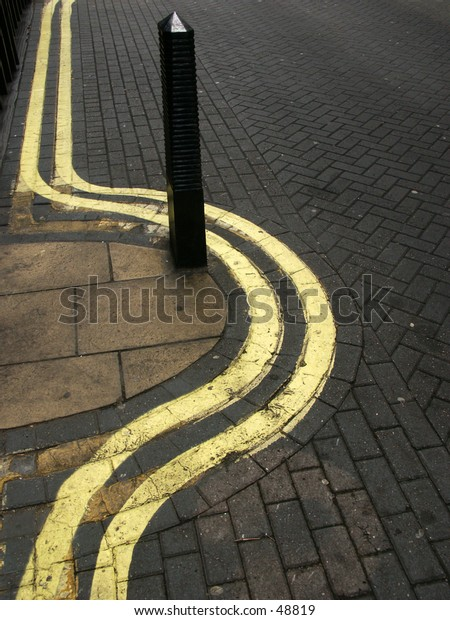 Double wiggly yellow lines from the streets of London.