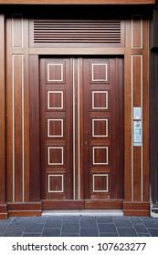 Double wooden door luxury entrance in building