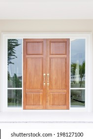 Double wooden doors with twin glass and frame