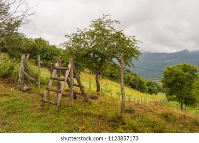 Double wooden ladder serving as a passage over a fence surrounding the park of Nebrodi north of Sicily