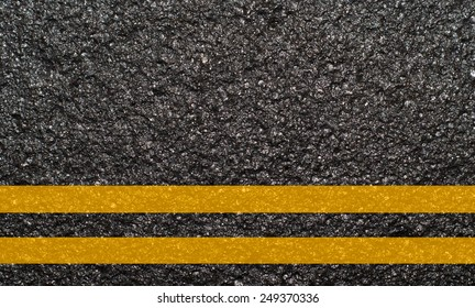 Double yellow line on asphalt texture