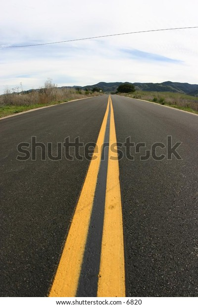 double yellow lines on a long road