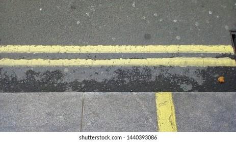double yellow street lines road marking in London