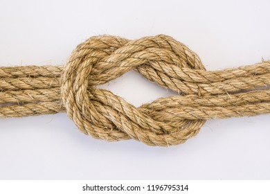 Doubled Reef knot in Sisal rope isolatedon white background.