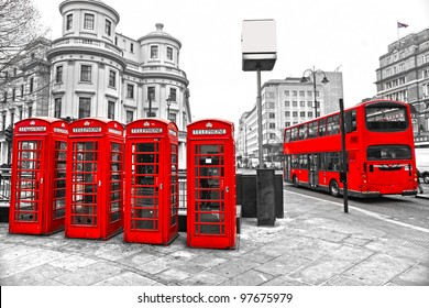 Double-decker bus and Red telephone boxes with black and white background, London, UK.