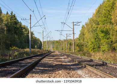Double-track electrified railway on a sunny autumn day