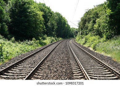 double-track railroad railway or train tracks in rural Germany, travel concept background with copy space