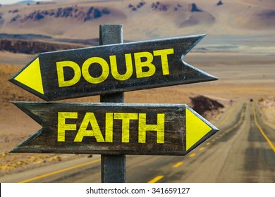 Doubt - Faith signpost in a desert road on background